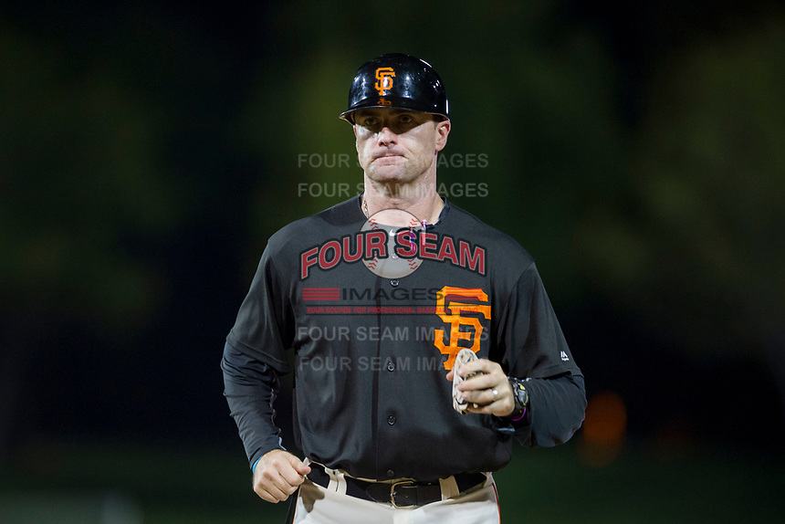 AZL Giants coach Doug Clark (43) jogs to first base during a game against the AZL Rangers on September 4, 2017 at Scottsdale Stadium in Scottsdale, Arizona. AZL Giants defeated the AZL Rangers 6-5 to advance to the Arizona League Championship Series. (Zachary Lucy/Four Seam Images)