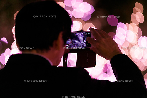 A man takes a picture of the illuminations at Shinjuku Terrace City on November 16, 2017, Tokyo, Japan. Shinjuku Terrace City Illuminations are seen around Odakyu Line Shinjuku Station. This year marks the 12th year of the illumination event, which can be enjoyed until February 22, 2018. (Photo by Rodrigo Reyes Marin/AFLO)