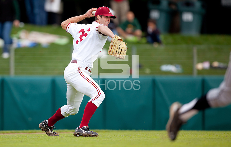 STANFORD, CA - March 27, 2011: Scott Snodgress of Stanford baseball throws the bunting batter out at first during Stanford's game against Long Beach State at Sunken Diamond. Stanford won 6-5.