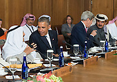 United States President Barack Obama talks to Sheikh Mohammed Al Khalid M Al Sabah of Kuwait while U.S. Secretary of State John Kerry talks to Sheikh Tameem Bin Hamad Al-Thani, Amir of the State of Qatar, during a working lunch at the Gulf Cooperation Council-U.S. summit at Camp David, the Presidential Retreat near Thurmont, Maryland, on May 14, 2015. Obama hosted leaders from Saudi Arabia, Kuwait, Bahrain, Qatar, the United Arab Emirates and Oman to discuss a range of issues including the Iran nuclear deal. <br /> Credit: Kevin Dietsch / Pool via CNP