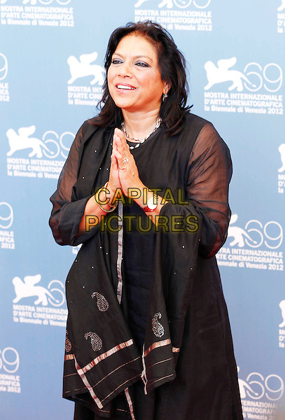 "Mira Nair, director.Photocall for ""The Reluctant Fundamentalist"" at the 69th Venice International Film Festival at Palazzo del Casino, Venice, Italy..August 29th, 2012.half length black sheer dress hands together praying .CAP/IPP.©IPP/Capital Pictures."