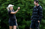 Brittney Dryland explains a shot to caddy Johnny Tynan during the Barfoot and Thompson Charles Tour, Akarana Open, Akarana Golf Club, Auckland, Sunday 17  April 2016. Photo: Simon Watts/www.bwmedia.co.nz