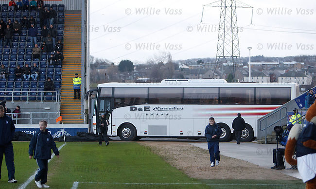 Ross County's team bus parked at the trackside as a makeshift windbreak