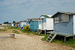 Colourful beach huts and shingle beach, Whitstable, Kent