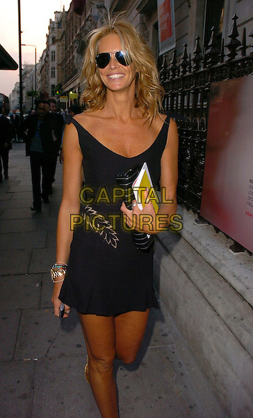 ELLE MacPHERSON.The 2006 Summer Exhibition Preview Party at the Royal Academy in Piccadilly, London, UK..June 7th, 2006 .Ref: CAV.half length black dress sunglasses shades.www.capitalpictures.com.sales@capitalpictures.com.© Capital Pictures.