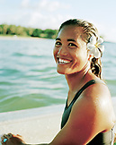 USA, Hawaii, The Big Island, portrait of a beautiful Hawaiian surfer girl holding her surfboard at the Mauna Kea Hotel