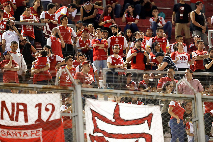 "BUENOS AIRES - ARGENTINA - 05 - 04 - 2018: Hinchas de Independiente Santa Fe, animan a su equipo durante partido de la fase de grupos, grupo D, fecha 2, entre River Plate (ARG) y el Independiente Santa Fe, por la Copa Conmebol Libertadores 2018, en el estadio Antonio Vespucio Liberti ""Monumental de River"", de la ciudad Ciudad Autónoma de Buenos Aires. / Fans of Independiente Santa Fe, cheer for their team during a match of the groups phase, group D, 2nd date, beween River Plate (ARG) and Independiente Santa Fe, for the Conmebol Libertadores Cup 2018, at the Antonio Vespucio Liberti ""Monumental de River"", in Ciudad Autónoma de Buenos Aires.  Photo: VizzorImage / Javier Garcia Martino / Photogamma / Cont."