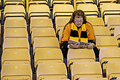 3rd November 2017, Molineux, Wolverhampton, England; EFL Championship football, Wolverhampton Wanderers versus Fulham; Wolverhampton Wanderers fan arrived early and reads the match programme in an empty stand