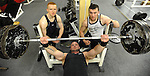 Power lifting champion Damien Casey in action watched by fellow champions  John Martin Cahill, left,  and Tom Humphreys in Sporty's Gym, Killarney.  Picture: Eamonn Keogh (MacMonagle, Killarney)