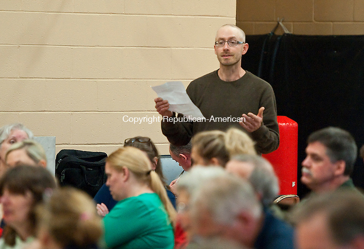 CLEBROOK, CT-052214JS03--Colebrook resident Shane Young voices his concerns during a public forum on a possible regional elementary school between the towns of Norfolk and Colebrook Thursday at Colebrook Consolidated School. <br /> Jim Shannon Republican-American