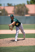 Oakland Athletics relief pitcher Jorge Martinez (61) follows through on his delivery during an Extended Spring Training game against the San Francisco Giants Orange at the Lew Wolff Training Complex on May 29, 2018 in Mesa, Arizona. (Zachary Lucy/Four Seam Images)
