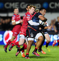 Mako Vunipola of Saracens is tackled by Rhys Patchell of the Scarlets. European Rugby Champions Cup match, between Saracens and the Scarlets on October 22, 2016 at Allianz Park in London, England. Photo by: Patrick Khachfe / JMP