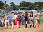 © Joel Goodman - 07973 332324 . 19/07/2013 . Suffolk , UK . Six women head towards tents at The Latitude music and culture festival in Henham Park , Southwold . Photo credit : Joel Goodman