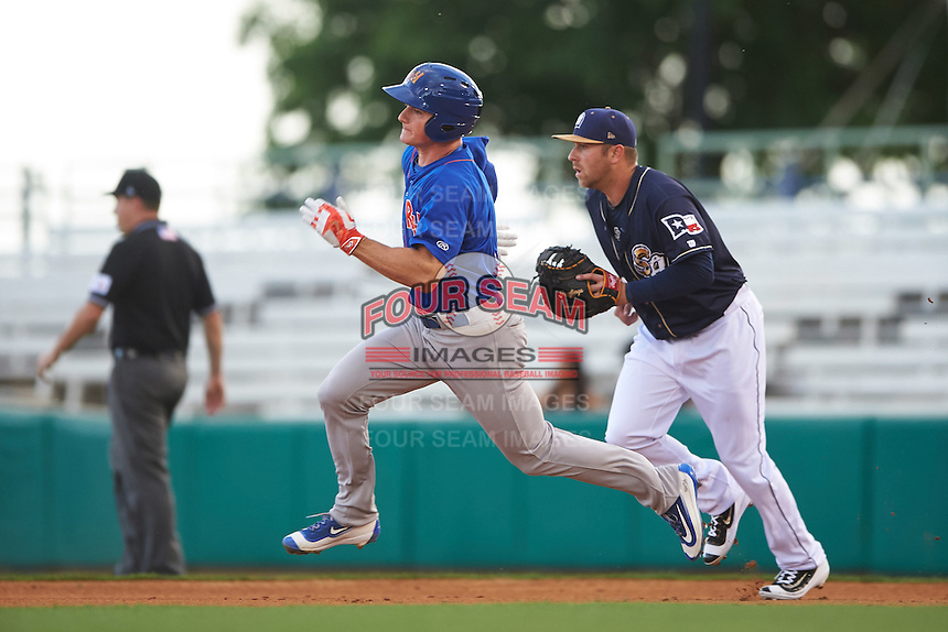 Midland RockHounds third baseman Matt Chapman (7) runs the bases as first baseman Mike Olt (40) trails during a game against the San Antonio Missions on April 21, 2016 at Nelson W. Wolff Municipal Stadium in San Antonio, Texas.  Midland defeated San Antonio 9-2.  (Mike Janes/Four Seam Images)