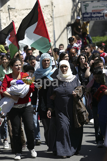 Israeli Arab demonstrators wave Palestinian flags during a demonstration marking the Land Day in the northern town of Sakhnin, March 30, 2010. Photo by Mohamar Awad