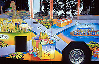 Singapore. Downtown. Town center. Orchard Road is mostly a place to shop with rows of modern shopping centres and the location for most international hotels. A bus has painted on its coachwork the various tourists spots of the town,like the zoo, a cruise on the river and the sale on Orchard Road. © 2001 Didier Ruef