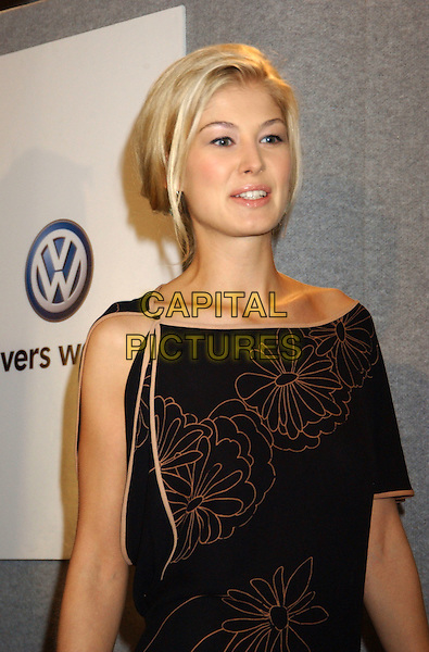 "ROSAMUND PIKE.For ""Pride & Prejudice""..The 2005 Toronto Film Festival press conferences held at Sutton Place Hotel, Toronto, Canada..September 11tth, 2005.Photo Credit: Laura Farr/Admedia.half length floral print tied top.www.capitalpictures.com.sales@capitalpictures.com.© Capital Pictures."