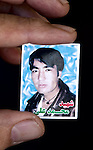 November 2012, Kabul , Afghanistan: A copy picture of 22 year old Mohammad Ali who was killed when a suicide bomber blew himself up at the Abdul Fazl shrine in Kabul, Afghanistan during last years Ashura festival that is celebrated by Shia muslims.  Ethnic Hazara's, who have often made up vast numbers of refugees to Australia, having been persecuted and driven from their homes in both Afghanistan as well as from Quetta in Pakistan where a lot of displaced Hazara fled to during the Taliban years. Hazara Shia muslims are looked down upon by the Sunni Pashto tribes that make up the population majority in Afghanistan. Picture by Graham Crouch/The Australian Magazine.