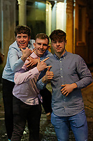 Pictured: Three young men pose for the camera. Sunday 31 December 2017 and 01 January 2018<br /> Re: New Year revellers in Wind Street, Swansea, Wales, UK