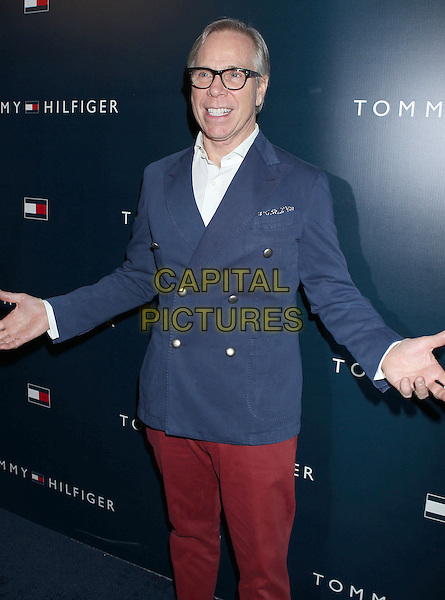 Tommy Hilfiger.Tommy Hilfiger West Coast Flagship Grand Opening Event, West Hollywood, California, USA, .13th February 2013 ..half length red white blue navy designer glasses blazer jacket double breasted trousers hands gesture shirt .CAP/ADM/RE.©Russ Elliot/AdMedia/Capital Pictures.