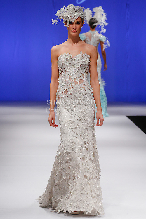 Model walks runway in a bridal gown from the Farage by Anna Romysh collection, during the Designer Spotlight Spring 2014 fashion show at New York International Bridal Week on October 13, 2013.