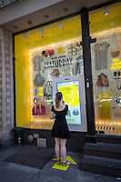 A pop-up kiosk sells Kate Spade merchandise in Soho in New York seen on Saturday, June 29, 2013. The experiment in shopping has an interactive touch screen that enables a shopper to purchase Kate Spade merchandise with same day delivery. (© Richard B. Levine)