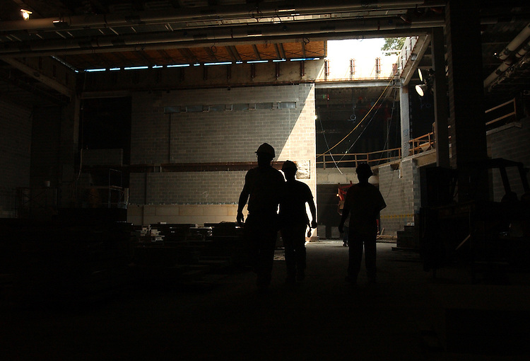 Workers move through the construction site of the Capitol Visitor Center.