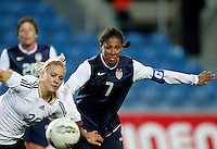 USA's Shannon Boxx fights for the ball with Germany's Leonie Maier during their Algarve Women's Cup soccer match at Algarve stadium in Faro, March 13, 2013.  .