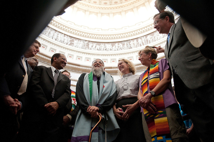 "WASHINGTON, DC - July 28: As Congressional leaders and The White House continue the standoff on increasing the debt limit, Christian and Jewish leaders gathered in a prayerful protest in the rotunda of the U.S. Capitol to urge Congress ""not to balance the budget on the backs of the poor."" At middle is Rabbi Arthur Waskow, of the Shalom Center in Philadelphia. They were arrested later by Capitol police for refusing to leave. Left to right: Rev. Paul Sherry, of Interfaith Worker Justice; Rev. Michael Livingston, past president of the National Council of the Churches of Christ; Waskow; Rev. Jennifer Butler, of Faith and Public Life; Sandy Sorenson, of the United Church of Christ; and Jim Winkler, general secretary of the United Methodist General Board of Church and Society. (Photo by Scott J. Ferrell/Congressional Quarterly)"
