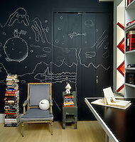 In this boy's bedroom the blackboard wall has been decorated in a black-and-white chalk mural based on drawings made by Paula Caravelli's children