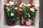 The Bravade annual festival 16th 17th and 18th of May Saint St Tropez South of France. 2005 A statuette and red and white flowers the colour of the festival on a village window sill. Every year the people of St Tropez celebrate the Bravades a ritual that expresses the deep attachment to their military history. This celebration now takes place over three days A huge effigy of Saint Tropez is carried from the chapel around the town and at particular places the parade stops and shots are fired into the air or at the ground continually hour after hour over the three day period as a salute to Saint Tropez