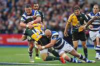 Ben Foden is double-tackled by David Wilson and Carl Fearns. Amlin Challenge Cup Final, between Bath Rugby and Northampton Saints on May 23, 2014 at the Cardiff Arms Park in Cardiff, Wales. Photo by: Patrick Khachfe / Onside Images