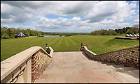 BNPS.co.uk (01202 558833)<br /> Pic:  KnightFrank/BNPS.<br /> <br /> Vast grounds...<br /> <br /> A stunning new Arts and Crafts style country manor which comes with its own lake, swimming pool, tennis court and summer house has come on to the market for £4.95million.<br /> <br /> Recently built Thakeham Manor, which also has a helipad, is set in 16 acres of landscaped parkland near Pulborough, West Sussex.<br /> <br /> Its eye-catching design, inspired by the famous early 20th century architect Edwin Lutyens, includes a slate roof, stone quoins and brick buttresses, while inside it is full of glamorous modern touches.<br /> <br /> The luxurious property has five bedrooms, five bathrooms and six reception rooms, and its grounds contain a heated swimming pool and decking area, a circular cushioned seating area and a tennis court.