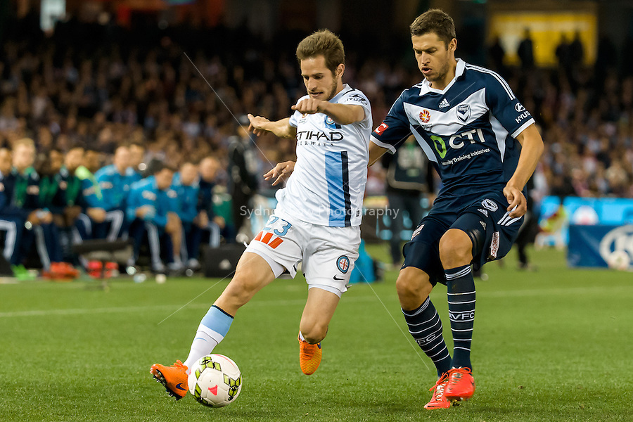 Mate Dugandzic of City and Mathieu Delpierre of the Victory fight for the ball in the semi final match between Melbourne Victory and Melbourne City in the Australian Hyundai A-League 2015 season at Etihad Stadium, Melbourne, Australia.<br />