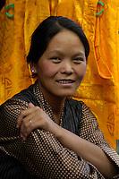A young Women from Tibet in Lhasa a shopkeeper, near Barkhor street, Tibet
