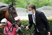 10.05.2020, Hoppegarten, Brandenburg, Germany; presenter Thorsten Castle interviews Rubaiyat after the victory at the Dr Busch Memorial
