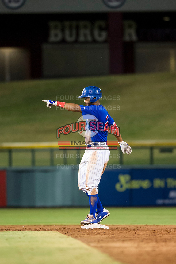 AZL Cubs right fielder Jonathan Sierra (22) points to the dugout in celebration after hitting a double during a game against the AZL Brewers on August 6, 2017 at Sloan Park in Mesa, Arizona. AZL Cubs defeated the AZL Brewers 8-7. (Zachary Lucy/Four Seam Images)