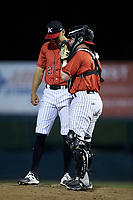 Kannapolis Intimidators catcher Evan Skoug (11) has a chat on the mound with relief pitcher Tyler Johnson (21) during the game against the Lakewood BlueClaws at Kannapolis Intimidators Stadium on April 6, 2018 in Kannapolis, North Carolina.  The BlueClaws defeated the Intimidators 4-3. (Brian Westerholt/Four Seam Images)