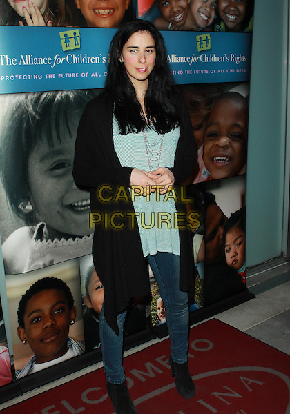"SARAH SILVERMAN.Alliance For Children's Rights ""Right To Laugh"" Fundraiser  held at the Catalina Jazz Club, Hollywood, California, USA..March 15th, 2010.full length top cardigan black green striped stripes grey gray silver necklace jeans denim oversized .CAP/ADM/TC.©T. Conrad/AdMedia/Capital Pictures."