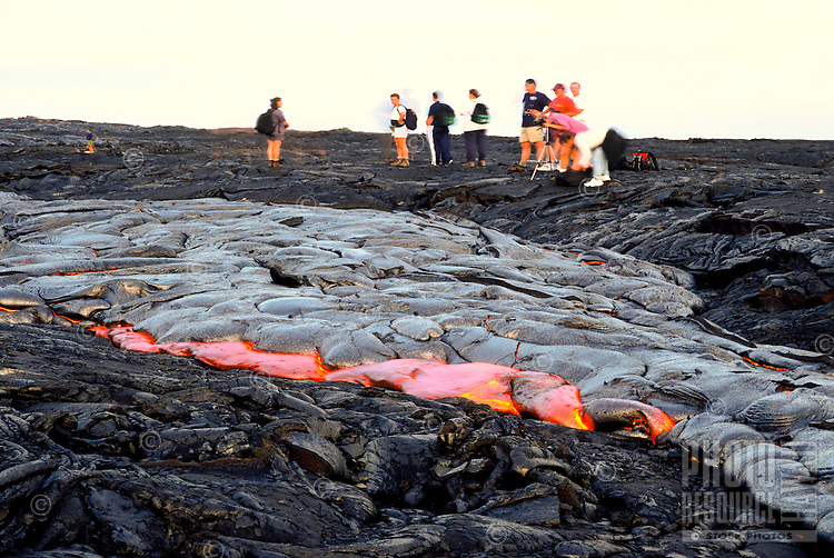 Spectators watch as new lava flows from Kilauea volcano, Hawaii volcanoes national park, Big Island