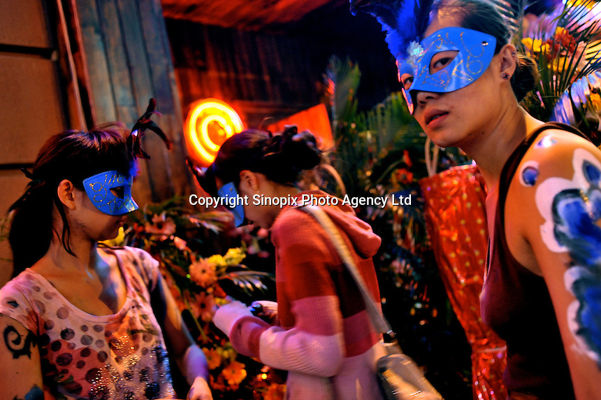 Girls prepare to go clubbing in the Kungdu entertainment district of Kunming, China. The area is well known for gangs that control drugs that are available in the area, many coming from Burma..May 2009...PHOTO BY SINOPIX