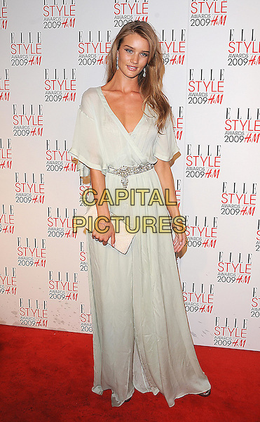 ROSIE HUNTINGDON-WHITELEY.The Elle Style Awards 2009, Big Sky London, London, England..February 9th, 2009.full length one shoulder Huntingdon Whiteley pale green floaty white kimono dress long maxi .CAP/BEL.©Tom Belcher/Capital Pictures.