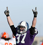 Tyler Newman #37 of the University of Sioux Falls celebrates after the Cougars advanced to the NAIA College Football national championship by defeating Missouri Valley College 11-10 Sunday afternoon December 2, 2007 at Bob Young Field in Sioux Falls, S.D. The national championship will be played against Carrol College of Montana December 15 in Savannah, TN.