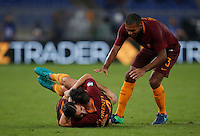 Calcio, Serie A: Roma vs Inter. Roma, stadio Olimpico, 2 ottobre 2016.<br /> Roma's Kostas Manolas, left, celebrates with teammates Alessandro Florenzi, center, and Juan Jesus, after scoring the winning goal during the Italian Serie A football match between Roma and FC Inter at Rome's Olympic stadium, 2 October 2016. Roma won 2-1.<br /> UPDATE IMAGES PRESS/Isabella Bonotto