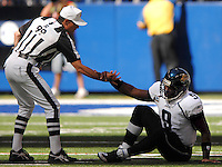 Referee #99 Tony Corrente helps Jacksonville Jaguars quarterback #9 David Garrard to his feet after he was hit by the Indianapolis Colts at Lucas Oil Stadium in Indianapolis, In. (The Florida Times-Union, Rick Wilson)