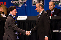 The Colorado Rapids first pick, and sixth overall Nico Colaluca shakes hands with MLS Commissioner Don Garber during the first round of the MLS SuperDraft at the Indiana Convention Center, Indianapolis, IA, on Jan 12, 2007.