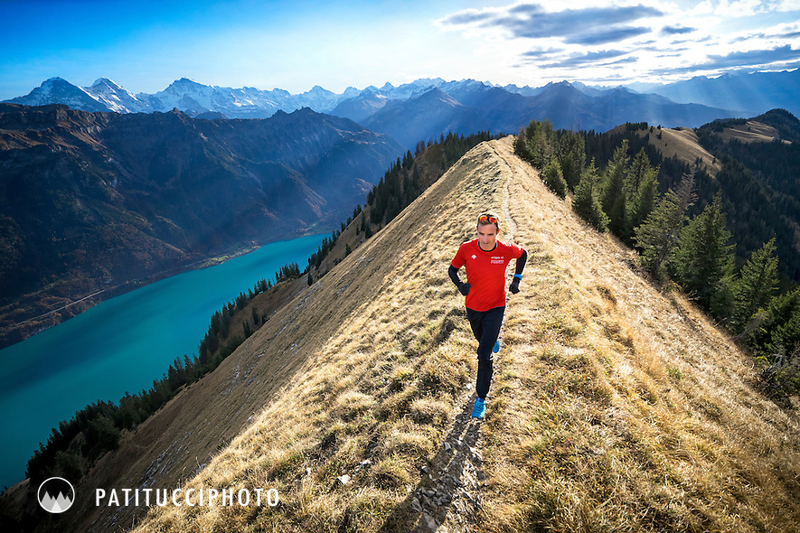 Trail running on the Hardergrat in late fall, a long ridgeline above Interlaken, Switzerland and the Brienzersee