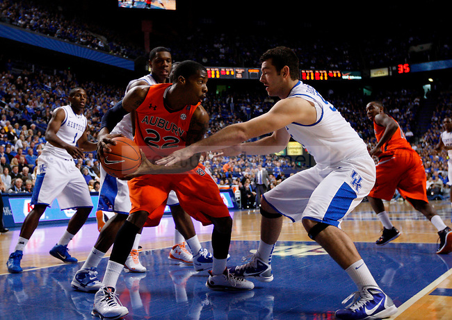 Josh Harrellson guards Kenny Gabriel in the first half of UK's win over the Auburn Tigers at Rupp Arena on Jan. 11, 2011. Photo by Britney McIntosh | Staff
