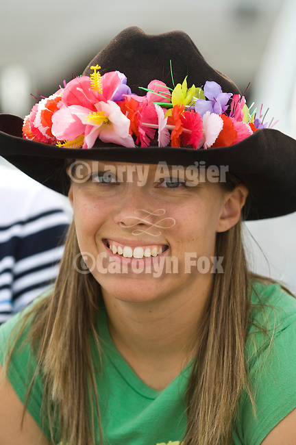 Kari Millhouse wears a colorful flower garland on her cowboy hat at the Jordan Valley Big Loop Rodeo