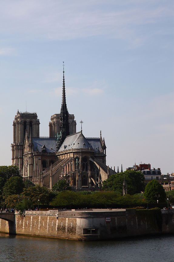 A view of the back of the church of Notre Dame in the Île de la Cité in Paris,  surrounded by the Seine river. Digitally Improved Photo.